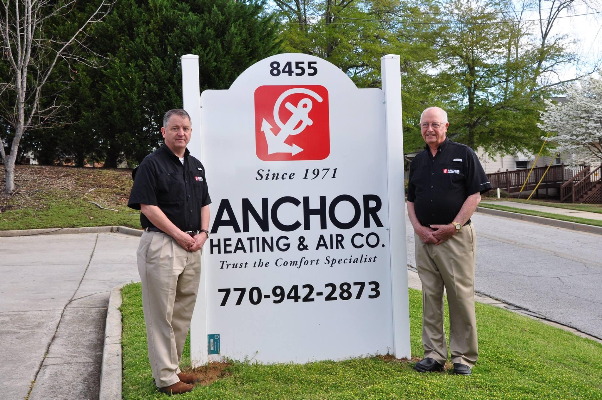 Jack and Barry Standing Next to Anchor AC Sign