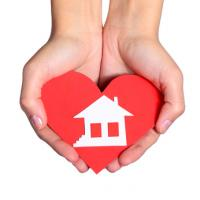 hands holding heart and house, dream home