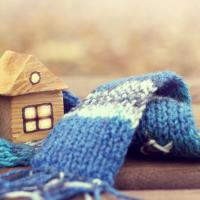 warm home concept, home model surrounded by wool scarf