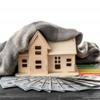 house model with scarf, money, and energy efficiency report