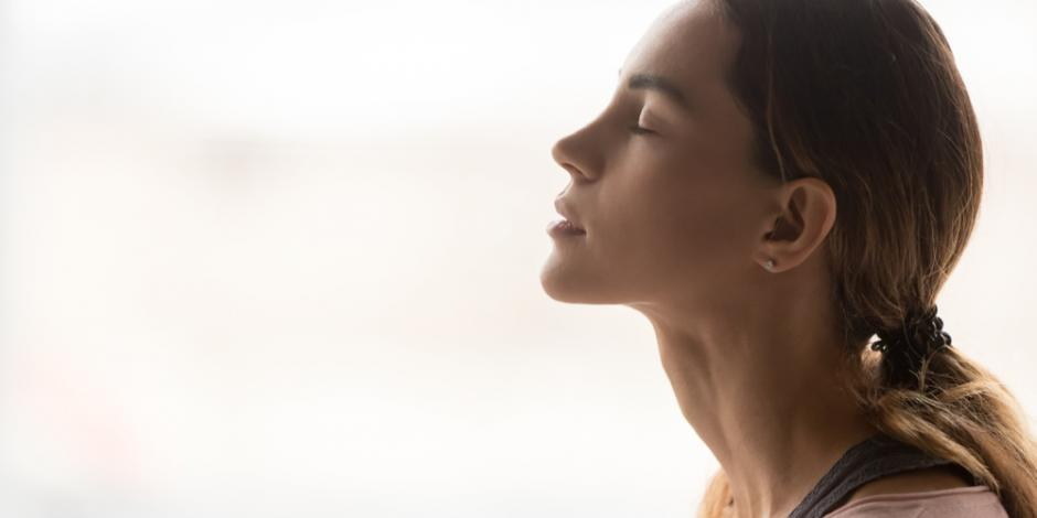 woman breathing in clean air at home