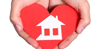 hands holding heart and home, dream home